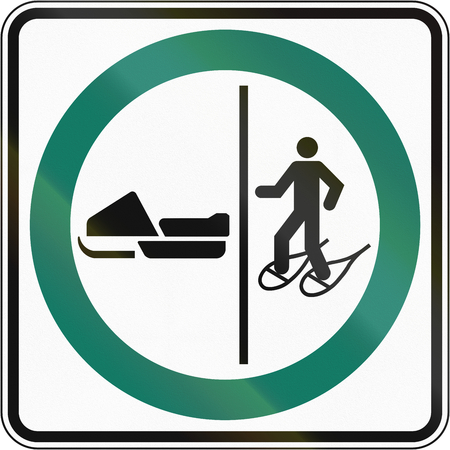 Regulatory road sign in Quebec, Canada - Snowshoeing and snowmobile lane.