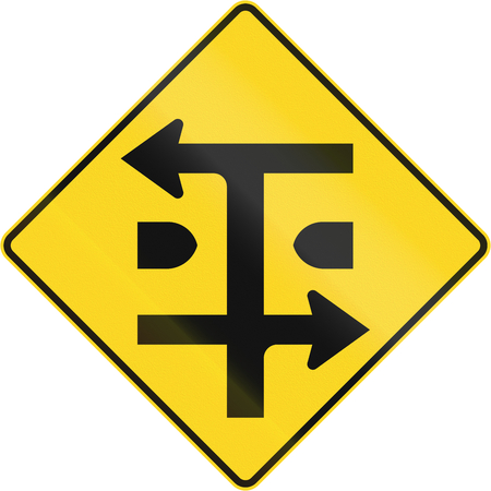 dual: An Canadian warning traffic sign - T-Intersection at dual carriageway. This sign is used in Quebec.