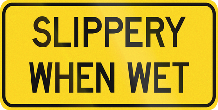 when: Warning road sign in Canada - Slippery when when. This sign is used in Ontario.