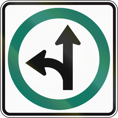 regulatory: Regulatory road sign in Quebec, Canada - Go straight or left. Stock Photo