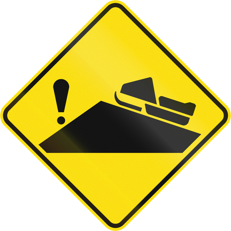 no skid: Warning road sign in Quebec, Canada - Hazard behind blindhead for snowmobiles. Stock Photo