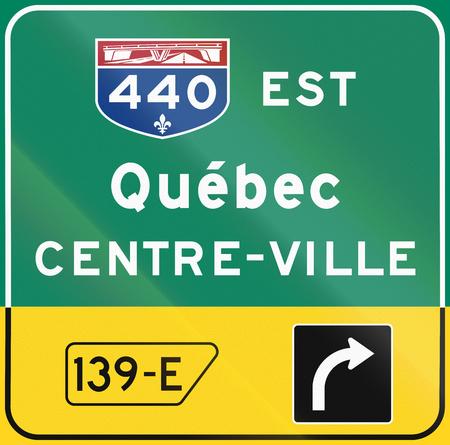 est: Guide and information road sign in Quebec, Canada - Direction sign above lane. Est means east, centre-ville means city center.