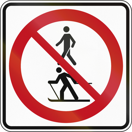 no skid: Regulatory road sign in Quebec, Canada - No skiers and pedestrians.