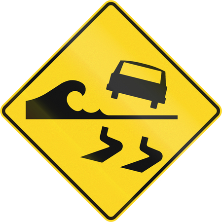 no skid: Warning road sign in Quebec, Canada - Danger of water from the left.