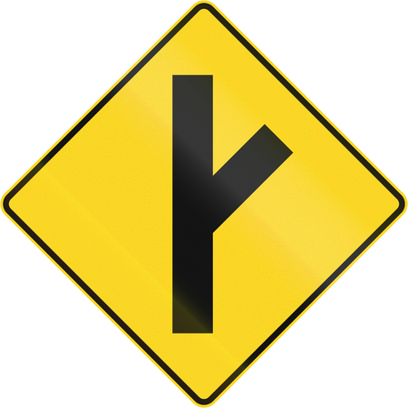arrow sign: Canadian road warning sign - 45 degree Intersection ahead. This sign is used in Quebec.