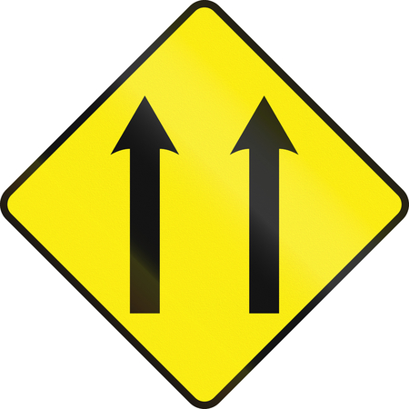 one lane road sign: An Irish road sign - Two lane area ahead Stock Photo