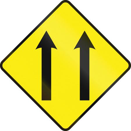 An Irish road sign - Two lane area ahead Stock Photo