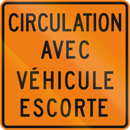 escort: TemporaryWorks road sign in Quebec, Canada - Traffic with escort vehicle. Stock Photo