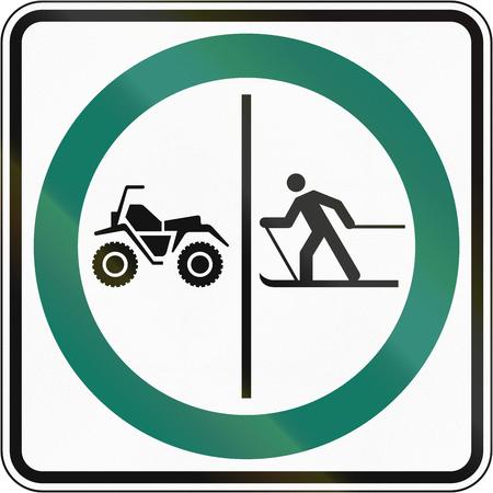 no skid: Regulatory road sign in Quebec, Canada - Skier and ATV lane.
