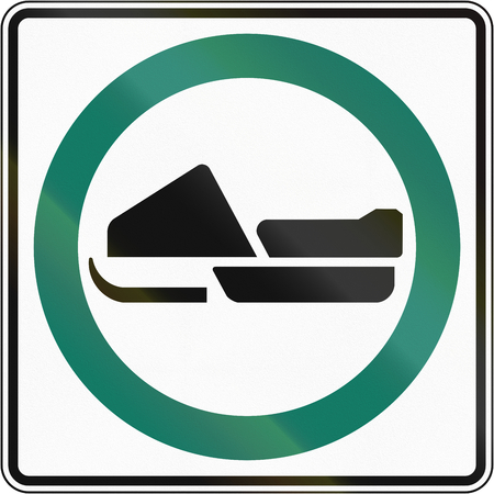 no skid: Regulatory road sign in Quebec, Canada - Snowmobile lane.