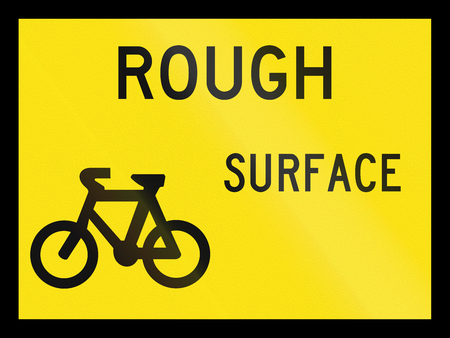 road surface: An Australian temporary road sign - Rough surface for cyclists