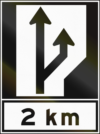 regulatory: Regulatory sign in Canada - Two lanes beginning. This sign is used in Ontario.