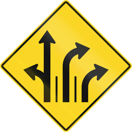 right handed: Warning road sign in Quebec, Canada - Three lanes with right turn lane. Stock Photo