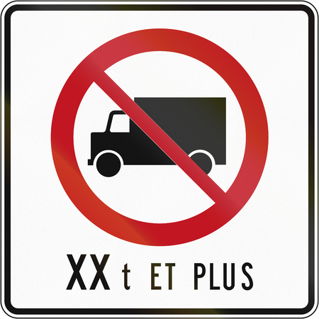 regulatory: Canadian regulatory traffic sign - No lorries. The text means: XX tons and more. This sign is used in Quebec. Stock Photo