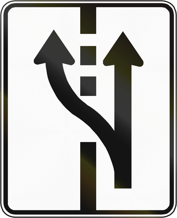 marking up: Regulatory road sign in Quebec, Canada - Two lane section begins.