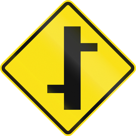 routing: Chilean road warning sign: Offset roads intersection ahead Stock Photo