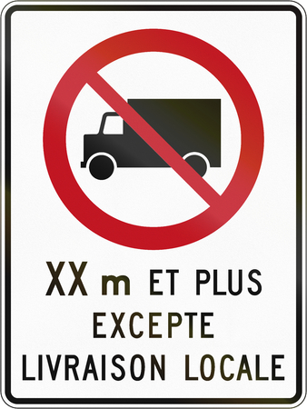 Canadian regulatory traffic sign - No lorries. The text means: XX meters and more - except local delivery. This sign is used in Quebec. Stock Photo