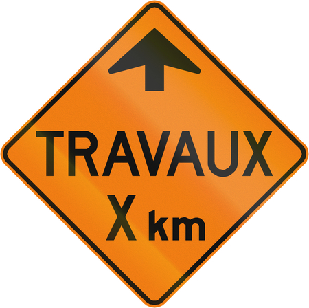 km: TemporaryWorks road sign in Quebec, Canada - Roadworks X km. Stock Photo