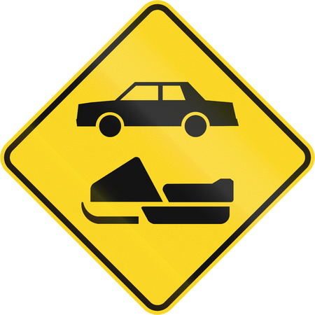 skidding: Canadian road warning sign - Snowmobiles and cars. This sign is used in Quebec.