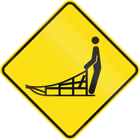 skidding: Warning road sign in Quebec, Canada - Sled crossing.