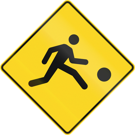 right handed: Warning road sign in Canada - Playing children. This sign is used in Quebec.