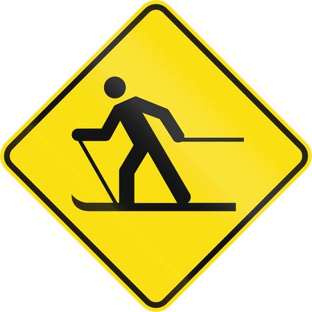 skidding: Warning road sign in Quebec, Canada - Skier crossing.