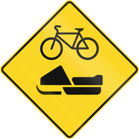 skidding: Warning road sign in Quebec, Canada - Snowmobiles and Bicycles.