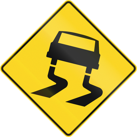 skidding: Canadian road warning sign: Slippery when wet. This sign is used in Quebec. Stock Photo