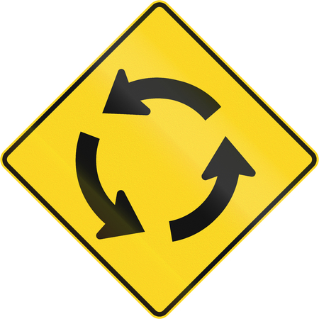 counterclockwise: Canadian road warning sign: Traffic circleroundabout ahead. This sign is used in Quebec.