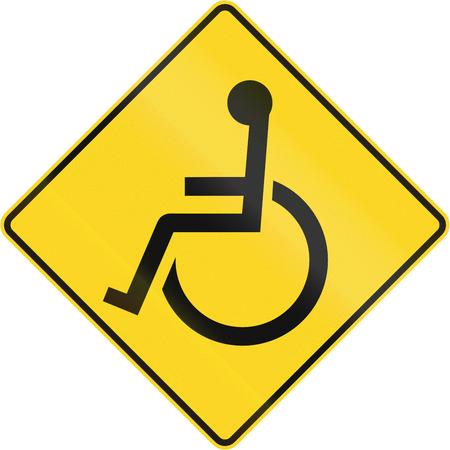 paraplegico: Advertencia señal de tráfico en Canadá - Discapacitados. Este signo se utiliza en Quebec. Foto de archivo