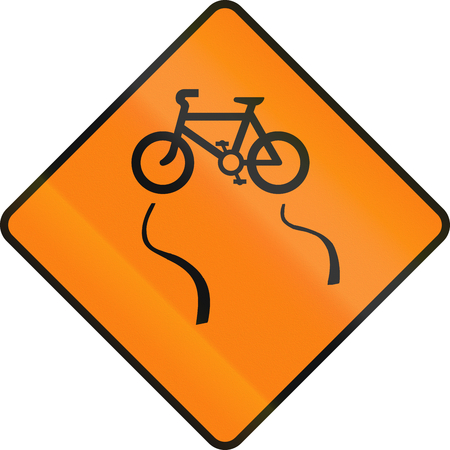 skidmarks: Irish temporary road warning sign - Slip danger for cyclists Stock Photo