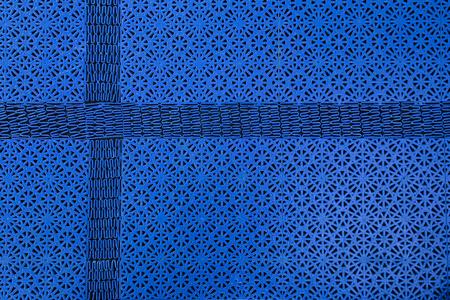 floor mat: Abstract shot of a floor mat pattern with cross shaped part, resembling a Nordic Cross.
