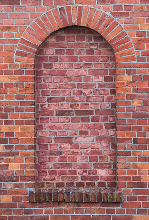 keystone: Arch in a wall made from red bricks.