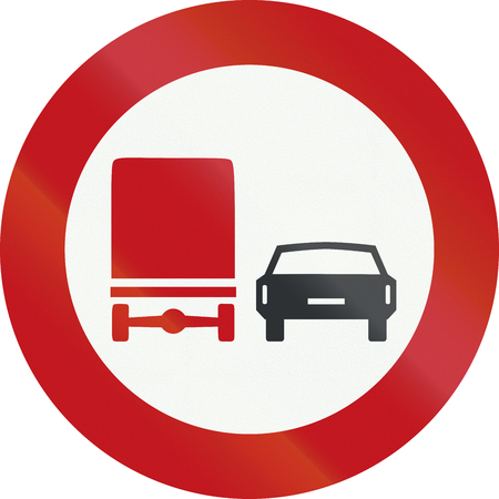 overtaking: A Dutch prohibition sign - No overtaking for trucks.