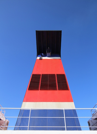 distorted image: Wide angle shot of the chimney of a passenger ferry. Stock Photo