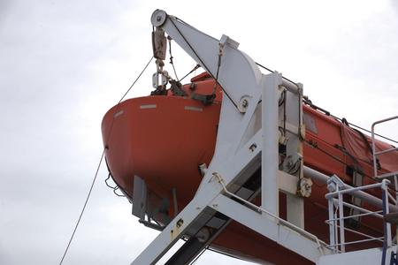 lifeboat: A Lifeboat hanging aboard a bigger ship.