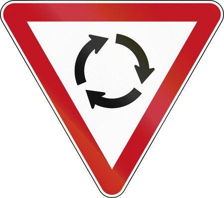 roundabout: New Zealand road sign RG-6R - Give Way at Roundabout.