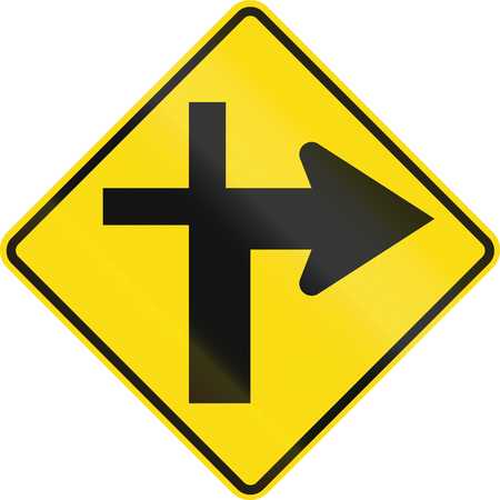danger ahead: New Zealand road sign - Crossroads ahead (priority turns right).