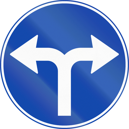 turn left: Norwegian mandatory direction sign - Turn left or right. Stock Photo