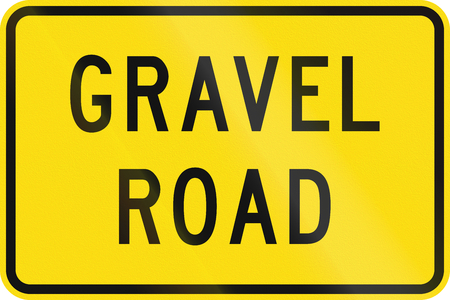 chippings: New Zealand road sign - Gravel road surface may be slippery.