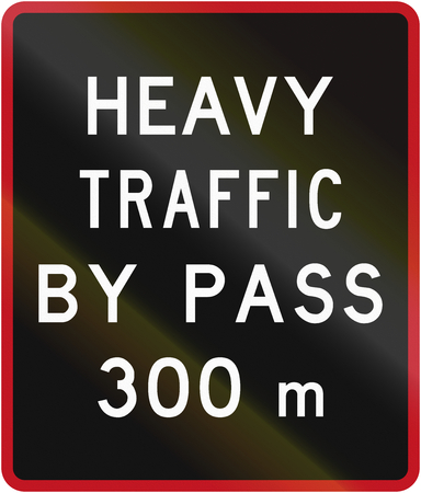 bypass: Old version of the New Zealand road sign - Bypass for heavy vehicles ahead in 300 metres. Stock Photo