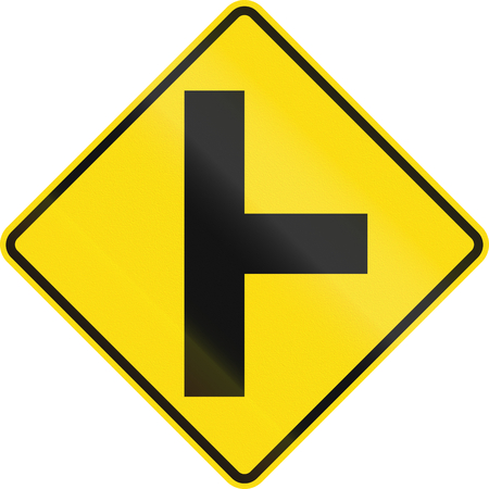 junction: New Zealand road sign - Side road junction uncontrolled on right. Stock Photo