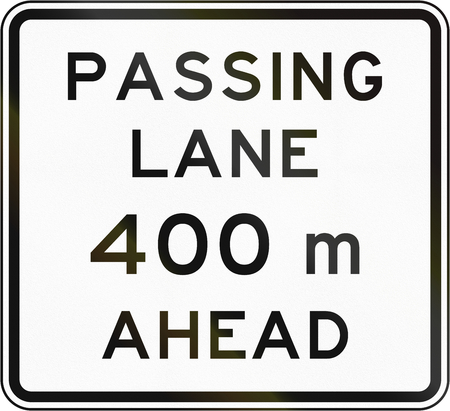 ahead: New Zealand road sign - Passling lane ahead in 400 metres. Stock Photo