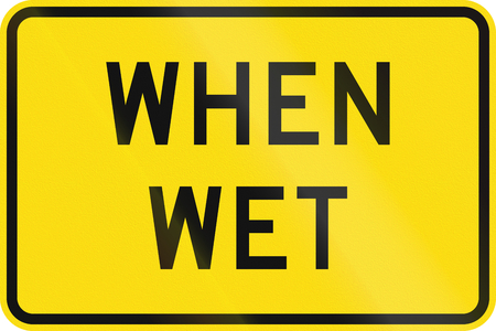 when: New Zealand road sign - Road surface slippery when wet. Stock Photo
