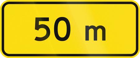 metric: New Zealand road sign - 50 metres ahead.