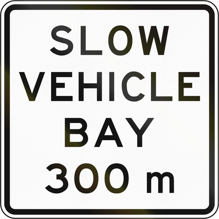passing the road: New Zealand road sign - Slow vehicle bay ahead in 300 metres.