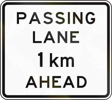 one lane road sign: New Zealand road sign - Passing lane ahead in 1 kilometre.