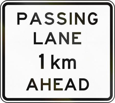 one lane roadsign: New Zealand road sign - Passing lane ahead in 1 kilometre.