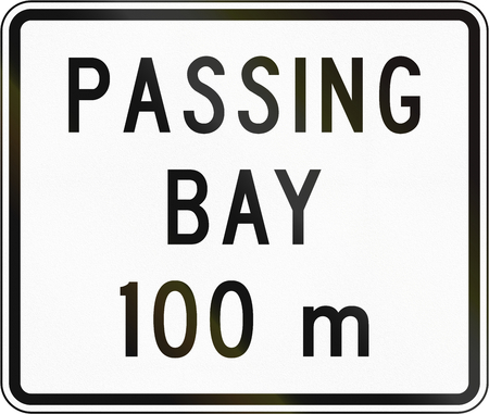 passing the road: New Zealand road sign - Passing bay ahead in 100 metres. Stock Photo