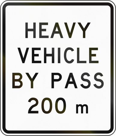 bypass: New Zealand road sign - Bypass for heavy vehicles ahead in 200 metres. Stock Photo